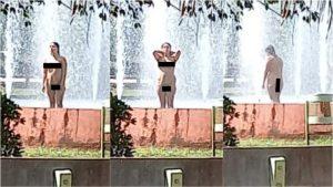Mulher nua é vista se refrescando em chafariz na Praça da Prefeitura